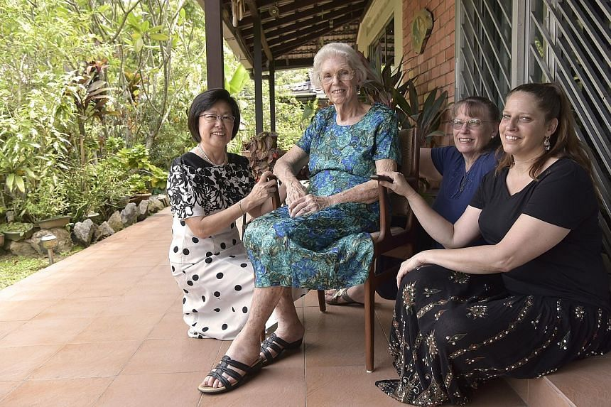 Reverend Dr Ernest Poulson was dean of Singapore Bible College for 30 years. He and his wife, along with two daughters, came to Singapore in 1953 and have stayed here since. Below: Mrs Verda Poulson, 91, with her (from left) god-daughter Koh Siang Ki