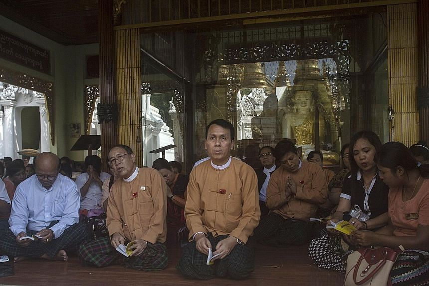 Mr Phyo Min Thein (centre) was handpicked by Aung San Suu Kyi for the post of Yangon's Chief Minister after joining the National League for Democracy in 2012. But he has drawn fire from the military and clashed with media outlets which question his h