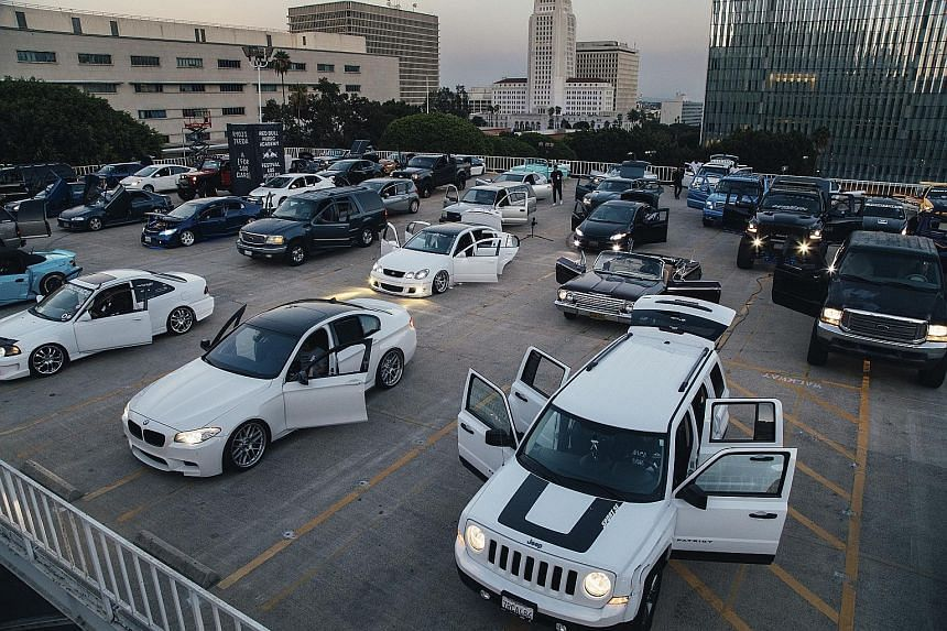 Cars gathered on the roof of a parking lot across the street from Frank Gehry's Walt Disney Hall to perform A (For 100 Cars), a composition by Ryoji Ikeda. Mr Edwin Hammond Meredith's 1978 Cadillac DeVille overheated during the performance and had to