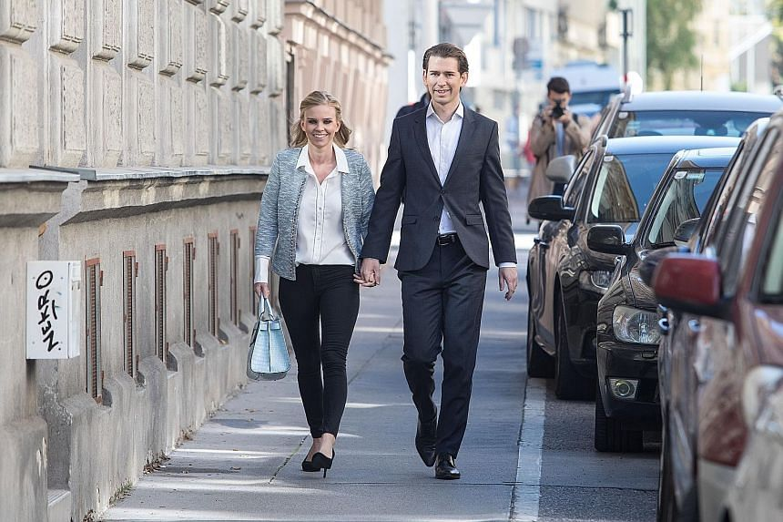 Above: Mr Sebastian Kurz, with partner Susanne Thier, is known for his slim-line suits, open collars, slicked-back hair and a tendency to forgo ties. Left: Mr Kurz changed his party's official colour from black to turquoise.