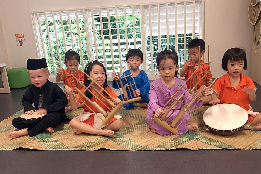 Pre-schoolers from My First Skool learning about the cultures of different races. Researcher Setoh Pei Pei is working on a project, involving at least 300 children from 30 My First Skool centres, to come up with materials for pre-schools, such as des