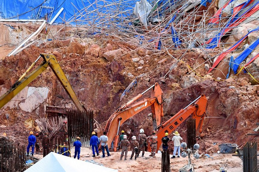 The authorities in Penang had initially said 13 foreign workers and a Malaysian supervisor were trapped under a landslide at a construction site last Saturday. But they clarified yesterday that the total number of workers buried was 11, as three work