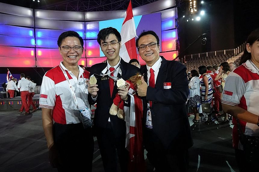 Above: (From left) Mr Ng Cher Pong, chief executive of SkillsFuture Singapore, Mr Ng Jun Xuan, a Nanyang Polytechnic student who won a gold medal at the WorldSkills international competition, and Mr Steven Low, senior manager for student development