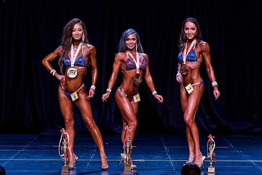 Angeline Huang, 29, was named the women's bikini national champion yesterday with Monica Wang, 31, second and Yumi Kishinami, 36, third. In other events at the FM League Singapore Nationals, Sasi Zura, 34, returned from a one-year break to win the Mr