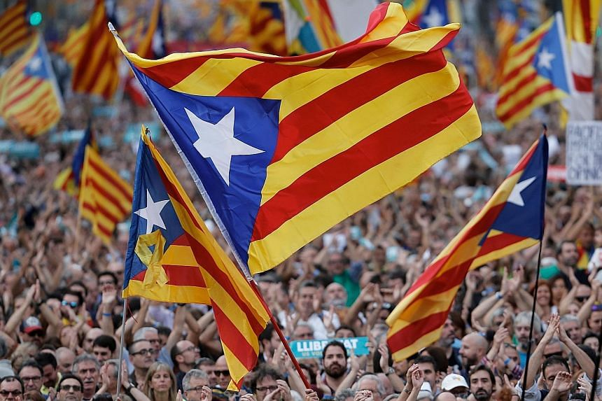Protesters waving pro-independence Catalan Estelada flags in Barcelona on Saturday. Catalan government spokesman Jordi Turull says there has been a full-fledged coup against the region's institutions.