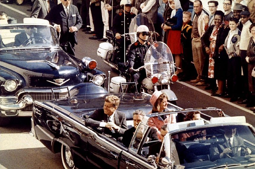 President John F. Kennedy and his wife Jacqueline Kennedy riding through Dallas just moments before his assassination on Nov 22, 1963.