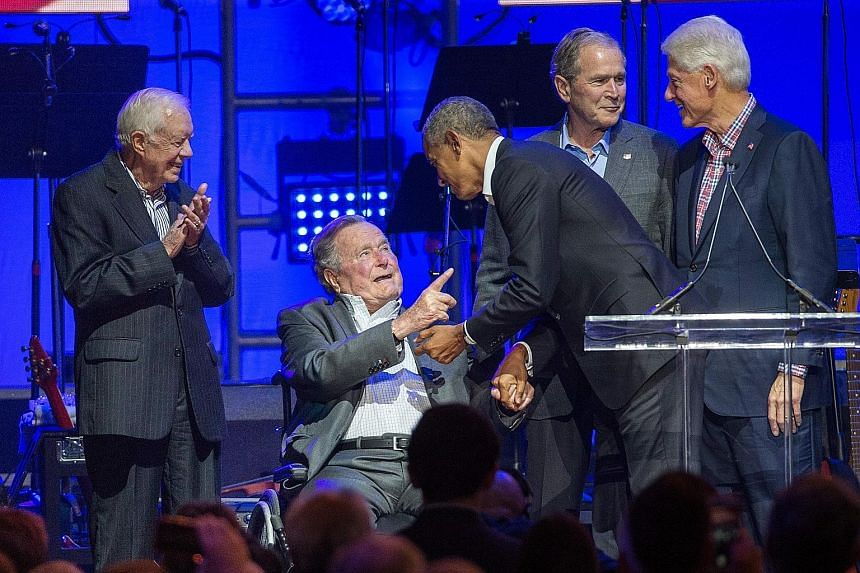 Former US presidents (from left) Jimmy Carter, George Bush, Barack Obama, George W. Bush and Bill Clinton at the hurricane relief concert in College Station, Texas, on Saturday. According to Mr George Bush's office, the effort by the three Democrats