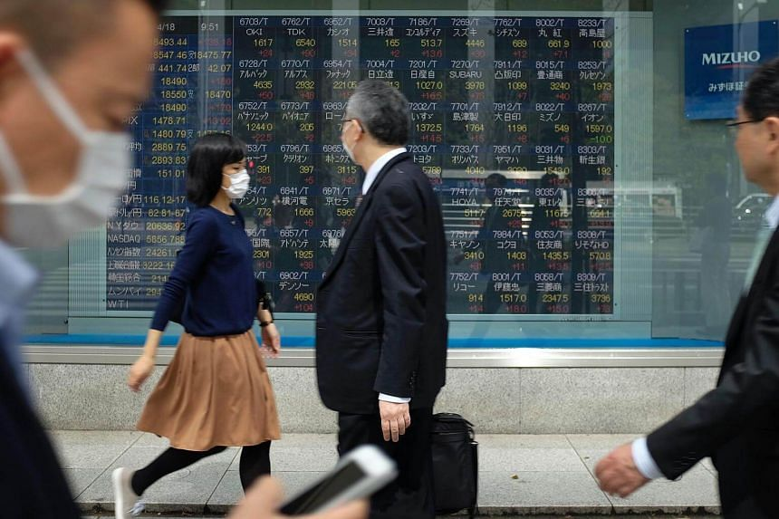 Japan's Nikkei raced up 1 per cent to its highest since 1996 after Prime Minister Abe looked to have easily won in national elections over the weekend.