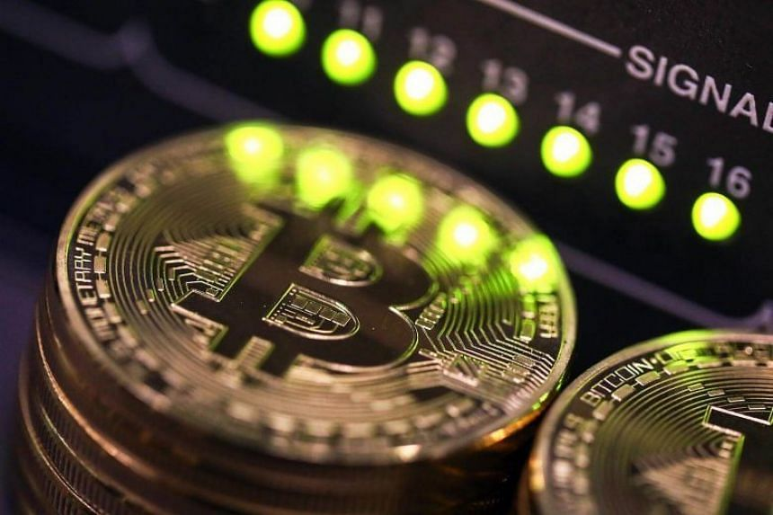 """Bitcoin's epic run, which dwarfs the US Dow Jones stock index's own impressive run-up of 17 per cent this year, is defying repeated warnings from big banks and policymakers, who have called it a """"fraud"""" and a """"bubble""""."""