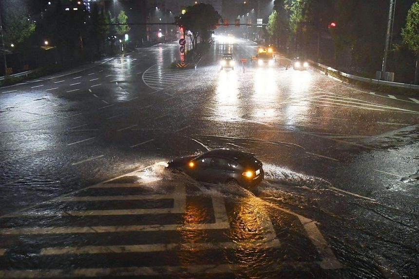 Water-covered road caused by heavy rains by Typhoon Lan is seen in Nagoya, on Oct 22, 2017.