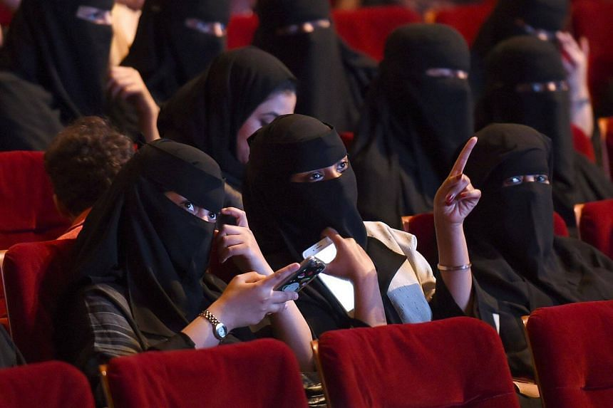 Saudi women attend the Short Film Competition 2 festival at King Fahad Culture Center in Riyadh, on Oct 20, 2017.