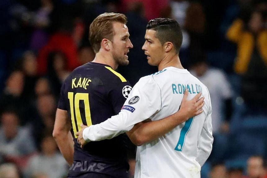 Tottenham's Harry Kane with Real Madrid's Cristiano Ronaldo after their Champions League match at the Santiago Bernabeu Stadium in Spain on Oct 17, 2017.