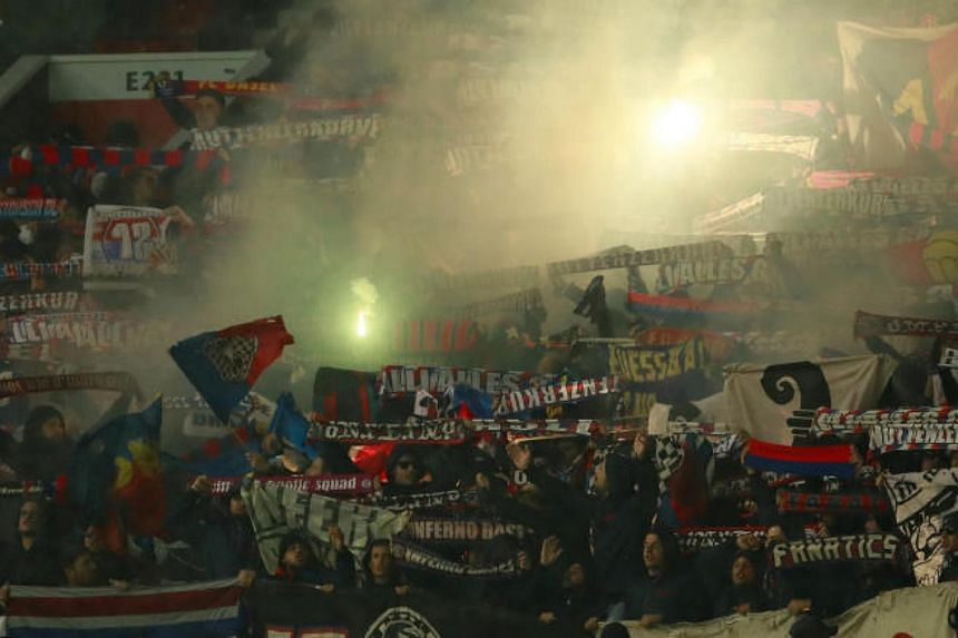 Basel fans with flares before the match on Sept 12, 2017.