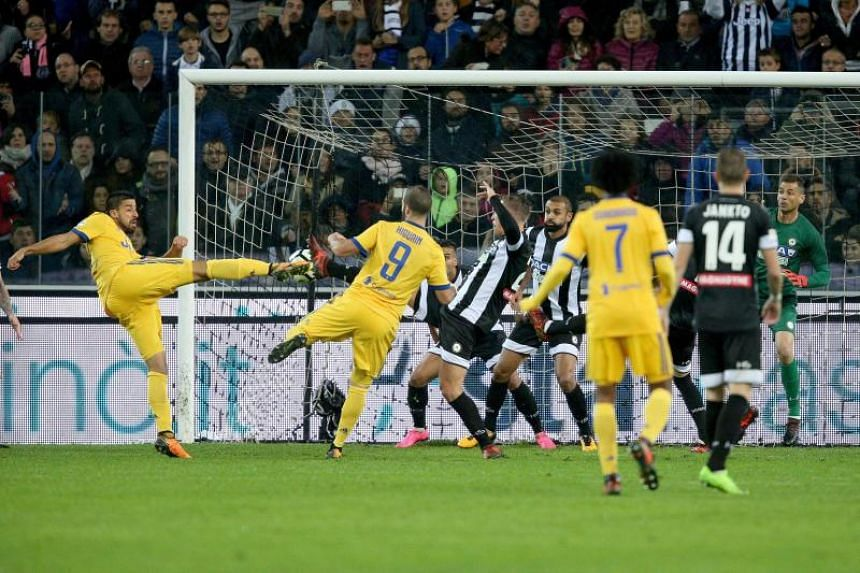 Juventus' Sami Khedira (left) scores the 2-5 goal during the Italian Serie A soccer match between Udinese Calcio and Juventus FC at Friuli stadium in Udine, Italy, on Oct 22, 2017.