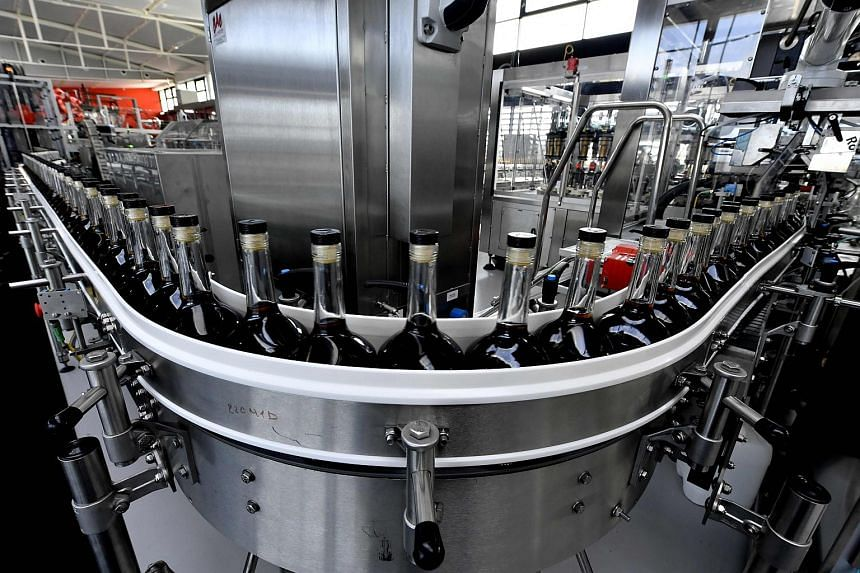 Bottles of cognac are pictured at the world leader for the production of Cognac Hennessy's new bottling plant on Oct 18, 2017 in Salles-d'Angles.