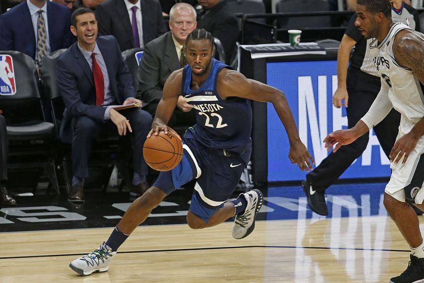 Andrew Wiggins #22 of the Minnesota Timberwolves drives for two against the San Antonio Spurs at AT&T Center in San Antonio, Texas, on Oct 18, 2017.