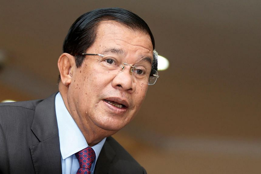 Cambodia's Prime Minister Hun Sen arrives before a plenary session at the National Assembly of Cambodia, in central Phnom Penh, on Oct 12, 2017.