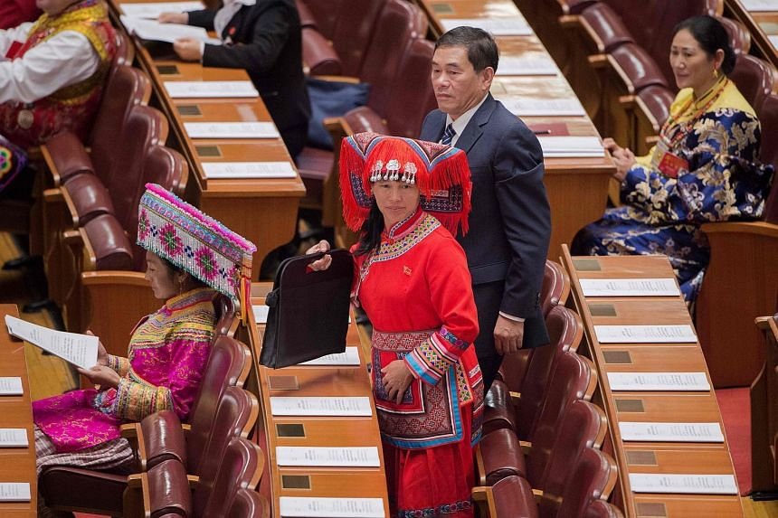 Delegates, some wearing ethnic minority outfits, arriving at the opening of the 19th Communist Party Congress at the Great Hall of the People in Beijing on Oct 18, 2017.
