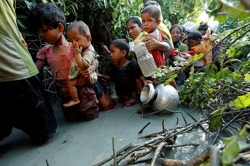 Rohingya refugees arrive to the Bangladeshi side of the Naf river after crossing the border from Myanmar, Bangladesh, on Oct 16, 2017.