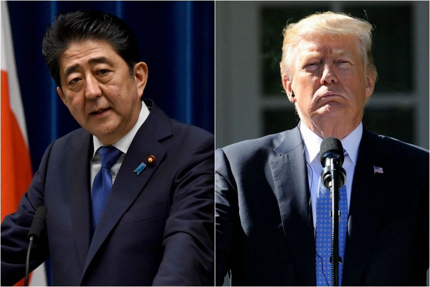 """Japanese Prime Minister Shinzo Abe (left) said on Monday (Oct 23) he would discuss North Korea """"thoroughly"""" with US President Donald Trump when he visits next month (November)."""