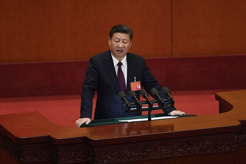 Chinese President Xi Jinping delivers a speech at the opening session of the Chinese Communist Party's Congress at the Great Hall of the People in Beijing on Oct 18, 2017.