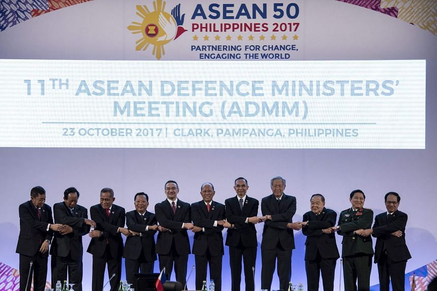 The Association of Southeast Asian Nations Defence Ministers at the 11th ASEAN Defence Ministers' Meeting opening ceremony in Clark, east of Manila on Oct 23, 2017. PHOTO: AFP