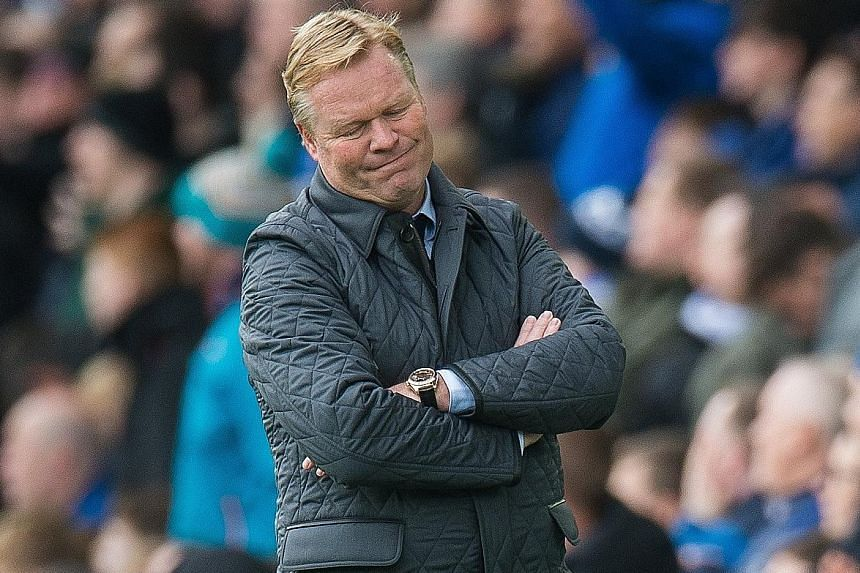 Everton manager Ronald Koeman looking on helplessly during the 5-2 home defeat by Arsenal on Sunday. The Toffees sacked the Dutchman after the loss left them in the Premier League relegation zone.