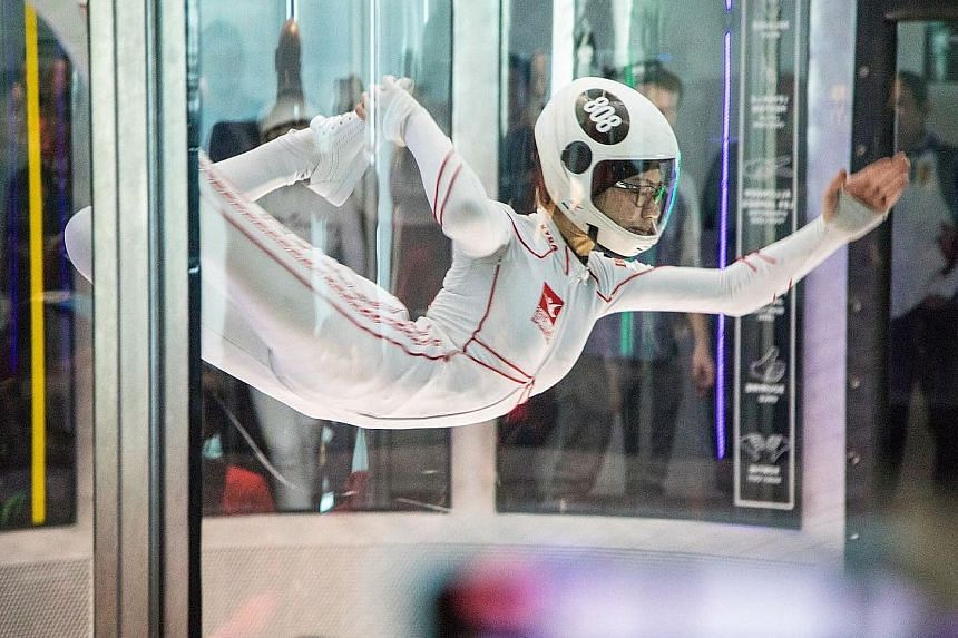 Kyra Poh soaring at last week's World Indoor Skydiving Championship in Canada, where she won an individual gold and teamed up with Choo Yi Xuan for a silver.
