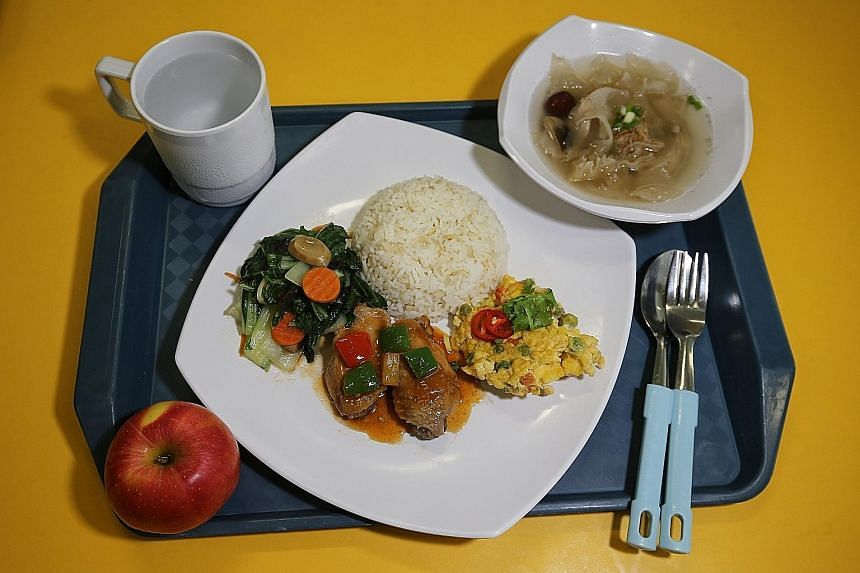 Above: Cookhouse food from a commercial vendor at Kranji Camp III. Above, left: A lower-calorie meal with less rice and one less meat serving.