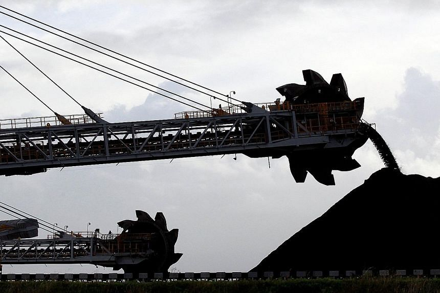 Coal stockpiles at the coal port in Newcastle, Australia. Many traders see a link between declining Asian coal futures and the growing dominance of a single firm in supplying physical Asian coal - London-listed Glencore, which is the world's biggest