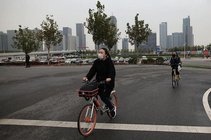Cyclists wearing face masks in Tianjin last week. The average PM2.5 reading for China's capital region, which includes Beijing and Tianjin, climbed 10.2 per cent from a year earlier.
