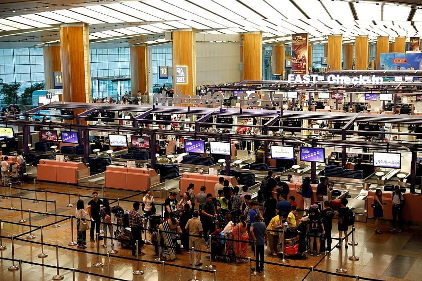 Travellers at Changi Airport Terminal 2 this month. Services inflation rose 1.5 per cent last month from 1.4 per cent in August, mainly due to a faster pace of increase in telecoms services fees. These more than offset a smaller rise in holiday expen