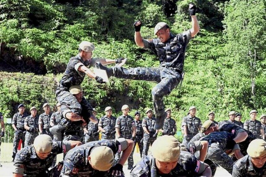 The VAT 69 Elite team performing a tactical self-defence action during their 48th anniversary programme at PGA Ulu Kinta, Perak.
