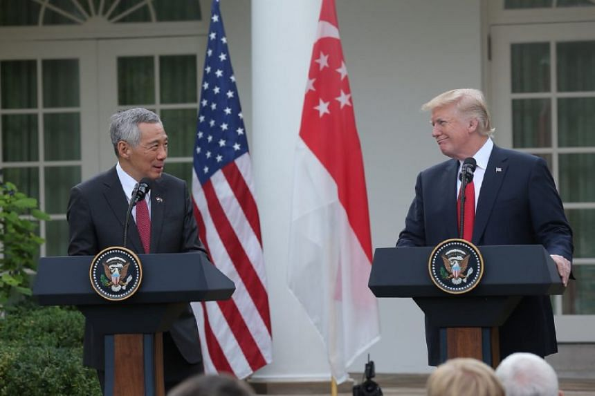 PM Lee and US President Trump deliver their joint statement at the Rose Garden on Oct 23, 2017.