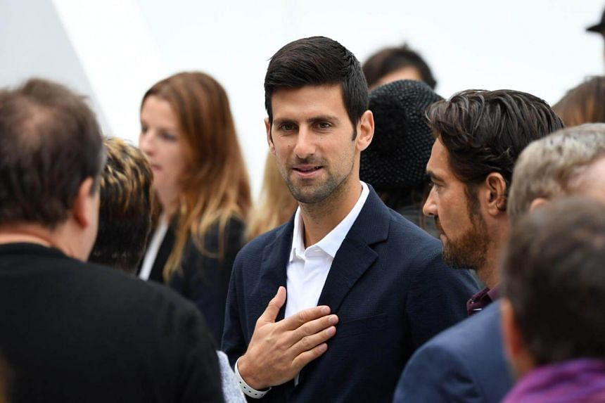 Serbian tennis player Novak Djokovic attends Lacoste women's 2018 Spring Summer ready to wear collection fashion show in Paris, on Sept 27, 2017.