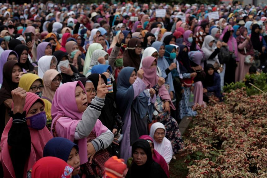 Women shout slogans during a protest against Indonesian President Joko Widodo's decree to disband Islamist groups in Jakarta, on July 18, 2017.