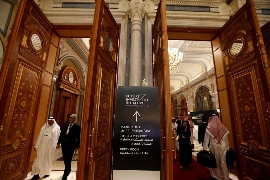 Participants walking around during the Future Investment Initiative conference in Riyadh, Saudi Arabia on Oct 24, 2017.