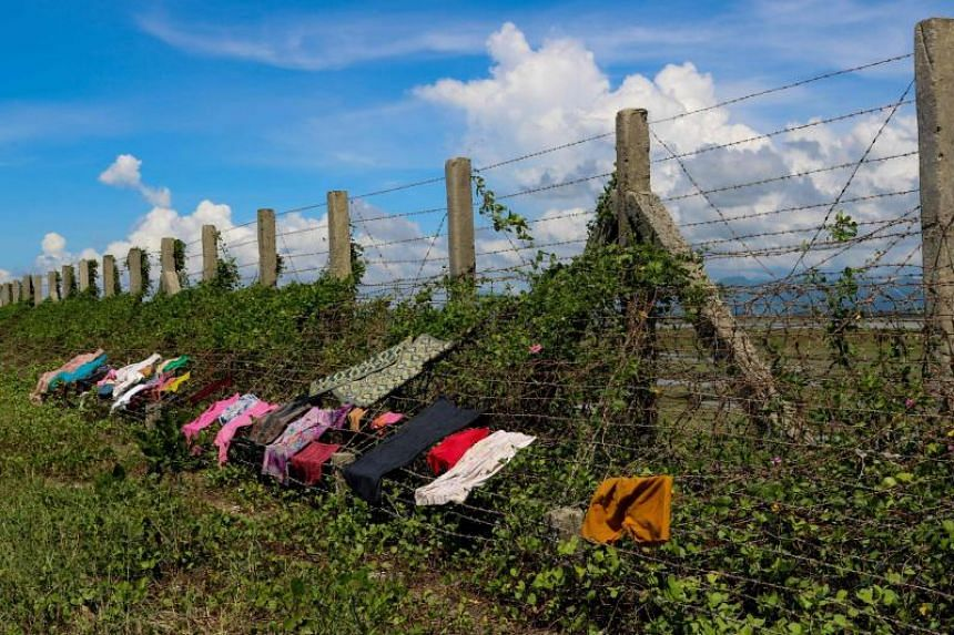 Clothes being dried on a barbed wire fence along the Myanmar-Bangladesh border near the Du Thar Ya village in Maungdaw, Northern Rakhine State on Oct 10, 2017.