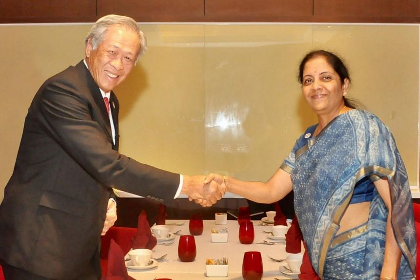 Singapore's Minister for Defence Ng Eng Hen and India's Defence Minister Nirmala Sitharaman shake hands during bilateral talks between both countries.