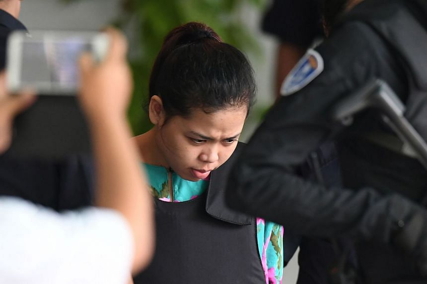 Indonesian defendant Siti Aisyah is escorted by police personnel following her appearance at the Malaysian Chemistry Department, on Oct 9, 2017.