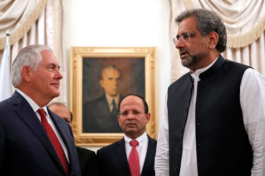 Rex Tillerson (left) is greeted by Pakistani Prime Minister Shahid Khan Abbasi before their Islamabad meeting.