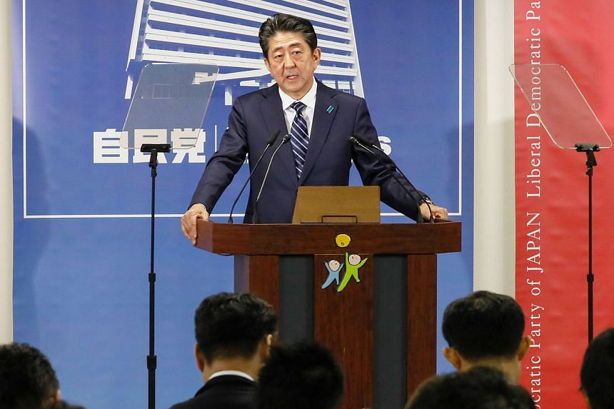 Japanese Prime Minister Shinzo Abe speaking at a news conference in Tokyo yesterday. He is expected to announce his new Cabinet next week, but does not look likely to make major changes to the line-up he assembled only in August.