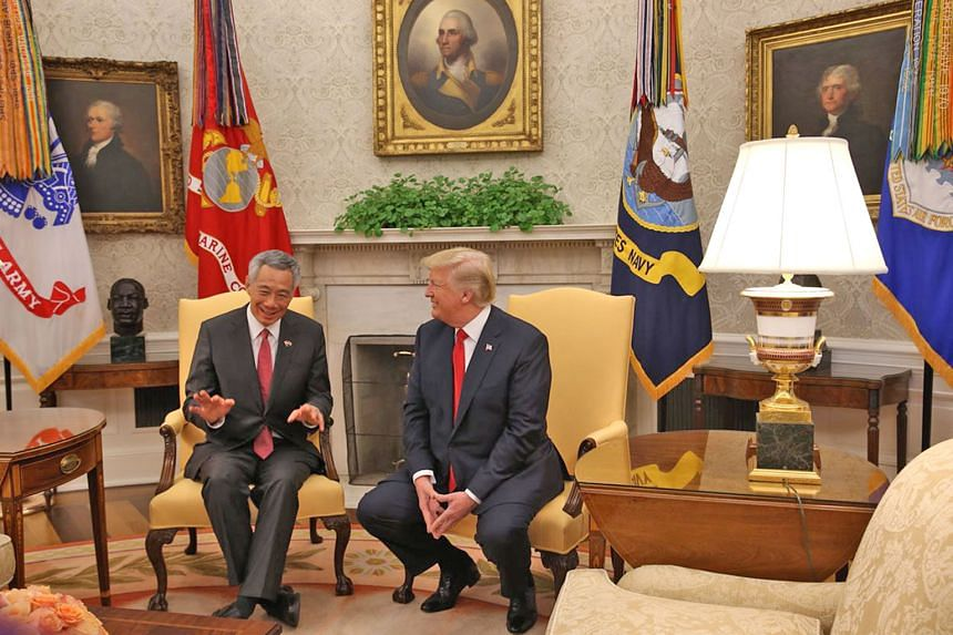 Prime Minister Lee Hsien Loong met President Donald Trump at the White House yesterday. Mr Trump congratulated PM Lee on Singapore's economy doing well, and Mr Lee said he looked forward to hearing Mr Trump's messages when the US President visits