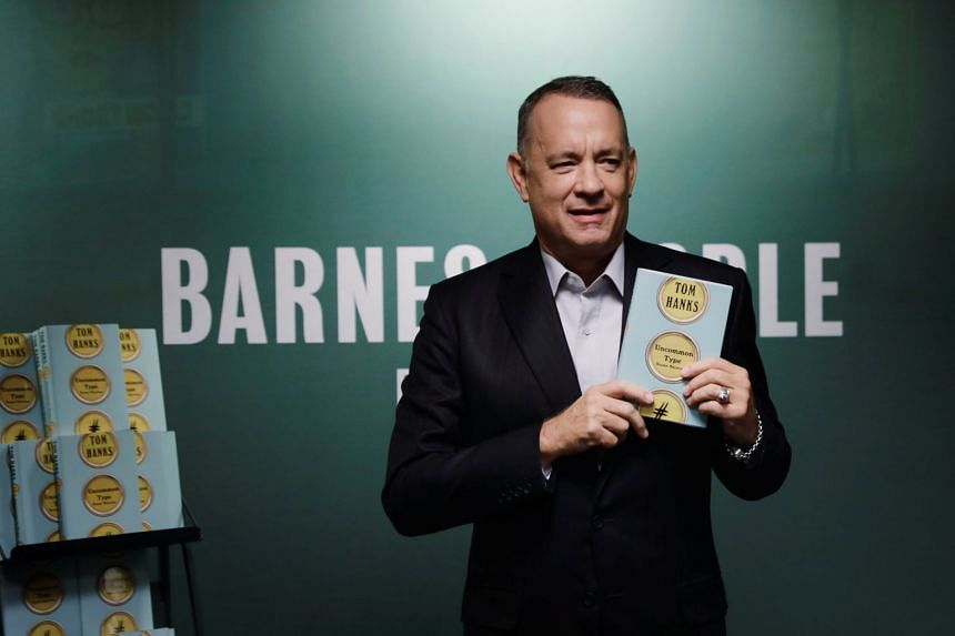 Tom Hanks holds a copy of his book at a promotional event for Uncommon Type: Some Stories, in New York.