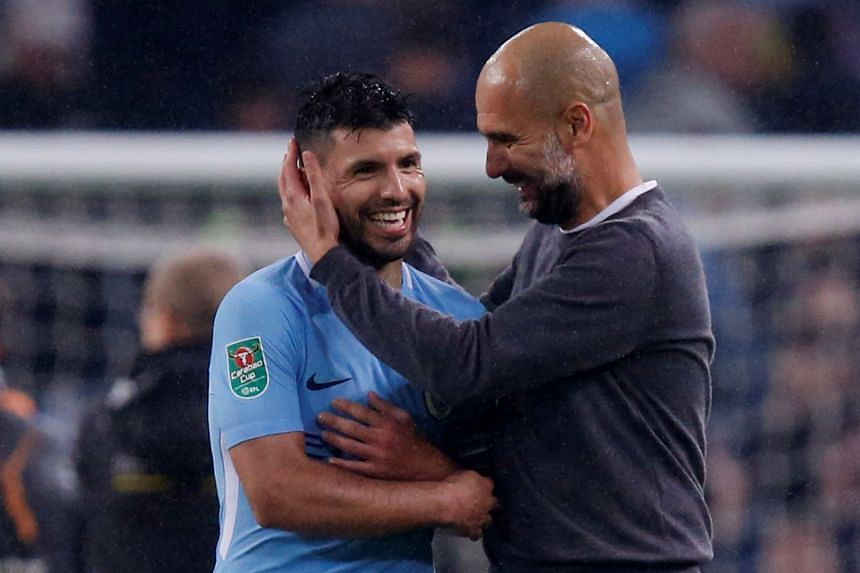Sergio Aguero and Manchester City manager Pep Guardiola celebrate after the match.