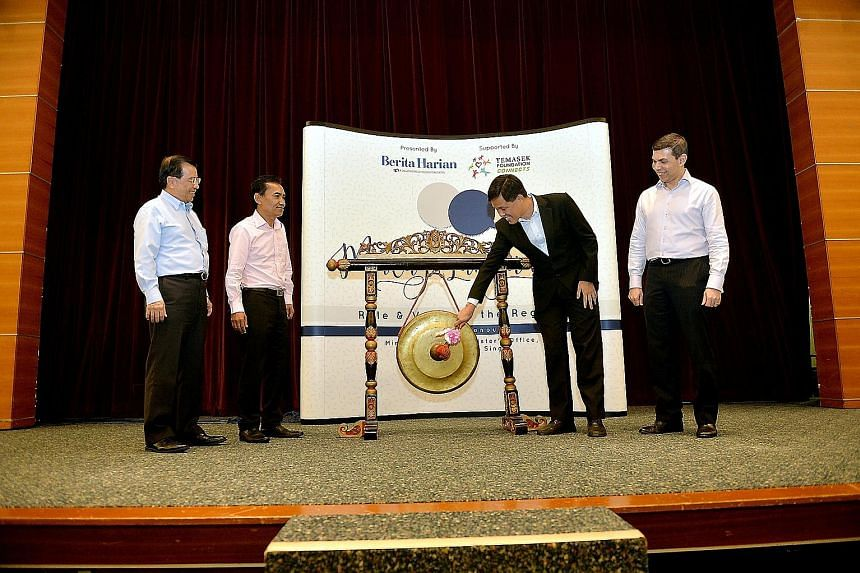 Mr Chan Chun Sing hitting a gong to open the BH forum at the SPH News Centre Auditorium yesterday. With him are (from left) Temasek Foundation Connects chief executive Lim Hock Chuan, BH editor Saat Abdul Rahman and SPH English/Malay/Tamil Media Grou
