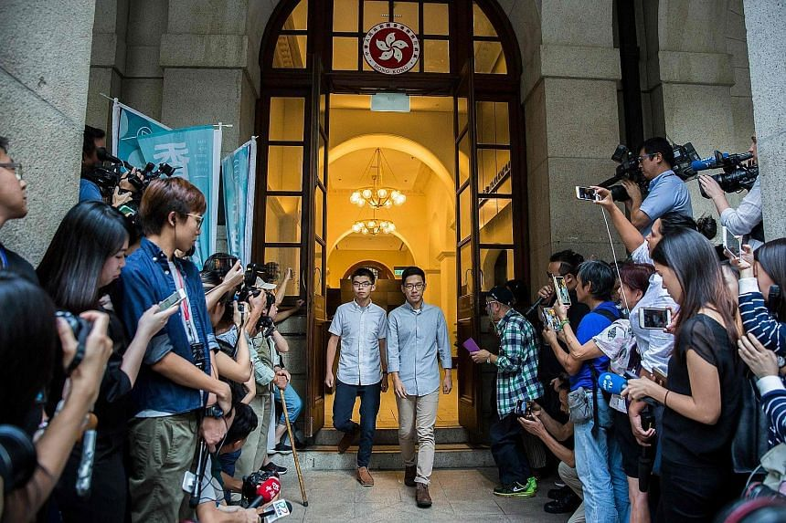 Activists Joshua Wong (left) and Nathan Law leaving Hong Kong's Court of Final Appeal yesterday, after succeeding in their bail applications. They were jailed for their roles in the 2014 Umbrella Movement.