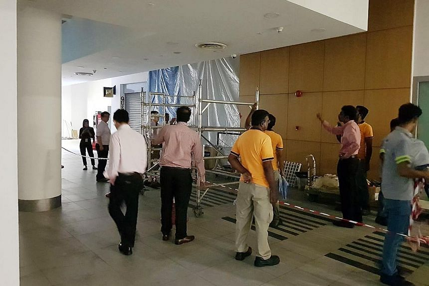Water leaking from a drainage pipe above the false ceiling had seeped through and caused the ceiling to fall, said an SMU spokesman. SMU's ground team responded immediately, cordoning off the area and clearing the mess.