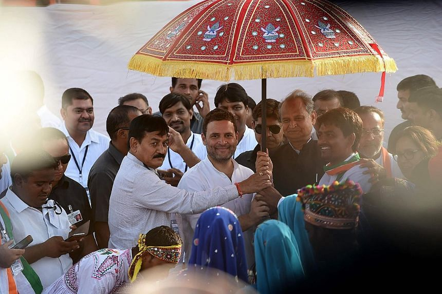 Congress vice-president Rahul Gandhi (centre) at a rally in Gujarat on Monday. He is traversing the western state where Prime Minister Narendra Modi made his name, to fire up his party workers.
