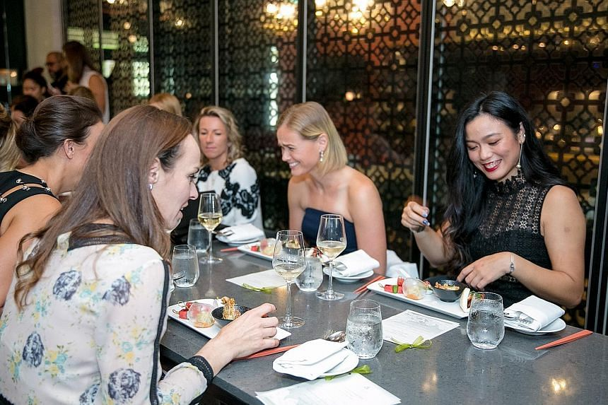 Chinese Taipei's Chan Yung-Jan and her Swiss doubles partner Martina Hingis (left) at the food tasting and official doubles draw ceremony of the BNP Paribas WTA Finals Singapore at Chijmes yesterday. The top seeds will face German Anna-Lena Groenefel